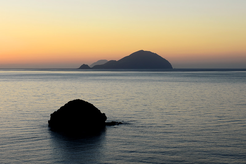 Sunset view from the island of Salina towards Filicudi and Alicudi, Italy