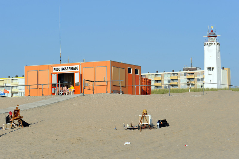 Painters and lifeguards at Noordwijk beach, The Netherlands