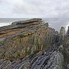 Angular unconformity between Silurian and Devonian sedimentary rocks, at Siccar Point along the coastal cliffs of southeast Scotland, United Kingdom