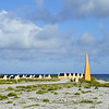 Historical navigation marker and slave huts in southern Bonaire