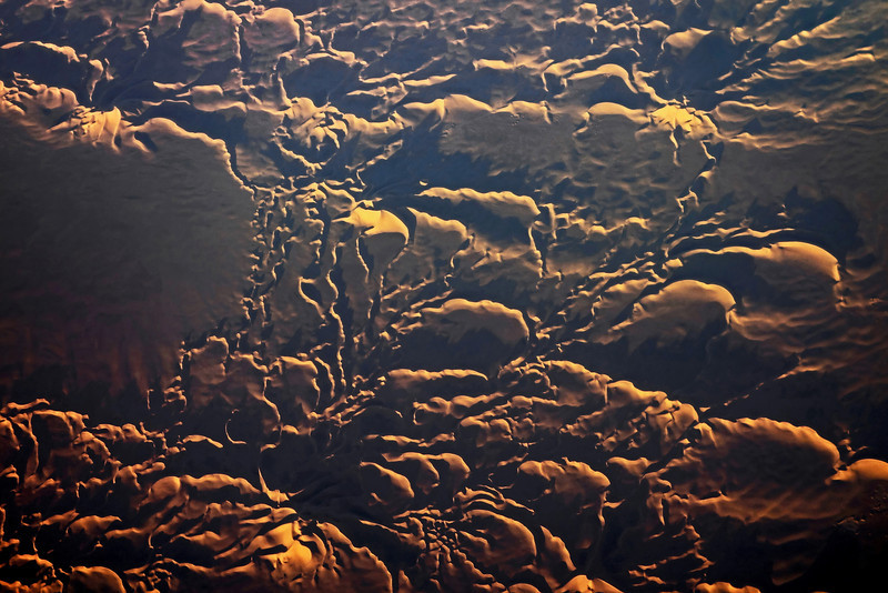 Winter sunrise lighting up large star dunes in the Sahara, southwest <br /> Algeria