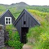 Grass covered wooden homes at Skogar, southern Iceland