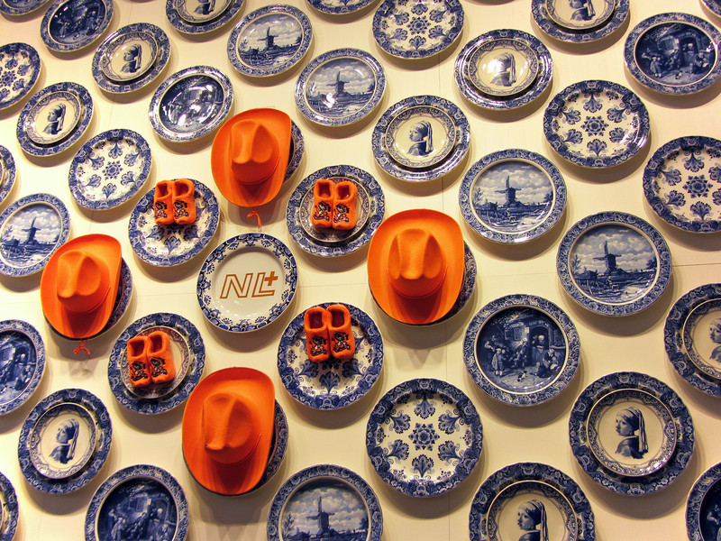Football's brilliant orange superimposed on traditional Delft's blue, The Netherlands