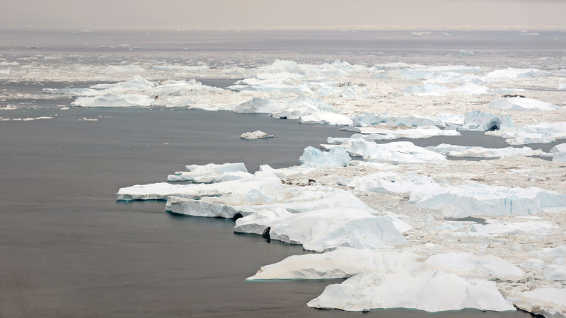 Aerial view of accumulated icebergs at the exit of the Ilulissat Icefjord, west Greenland