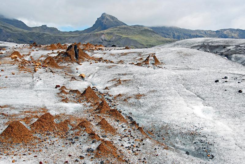 Rock mounds on glacier, southern Iceland
