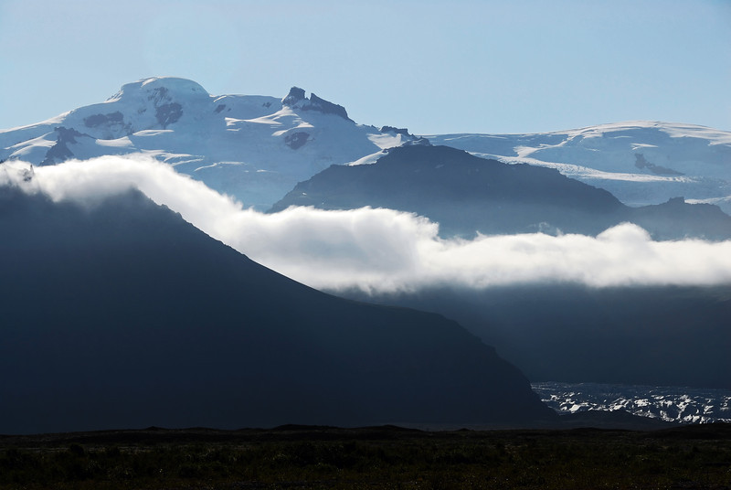 Morning fog over glacier at the base of the Öræfajökull volcano (2119 m) near Skaftafell, Iceland