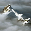 Icy ridge piercing through the clouds, Canadian Rockies