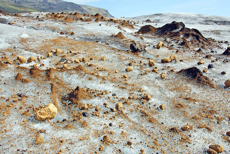 Volcanic rocks resting on Svinafellsjökul glacier, Iceland