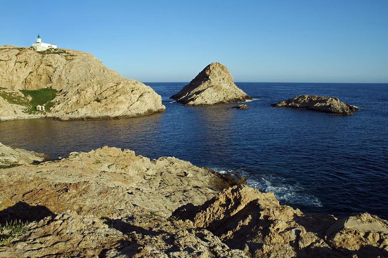Sunrise at L'Ile Rousse granite cliffs in north Corsica, France