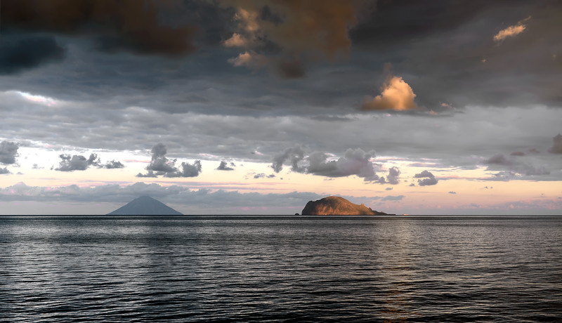 Sunset over Stromboli volcano and Panarea island, Italy