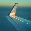 Reflections on airplane wing(let) just before sunset above North Africa