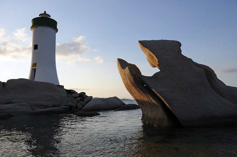 Lighthouse on granitic rocks at Porto Faro, Sardinia, Italy