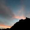 Last sunrays over volcanic promontory on Vulcano island, Italy