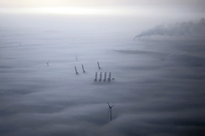 Ground fog covering Amsterdam harbour, The Netherlands