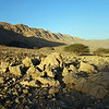 Low angle sunlight over rock desert in the northern Saih Hatat, Oman