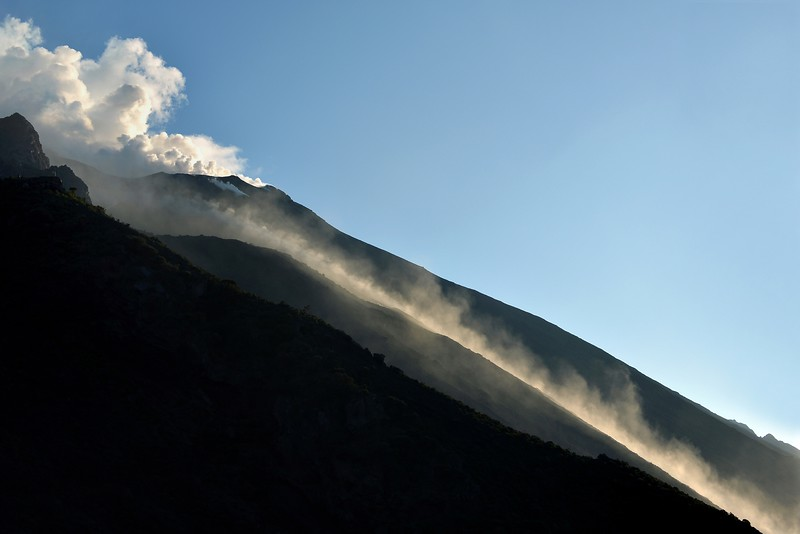 Dust trails of volcanic bombs rolling down to the sea along the Sciara del Fuoco slope of the Stromboli volcano, Italy