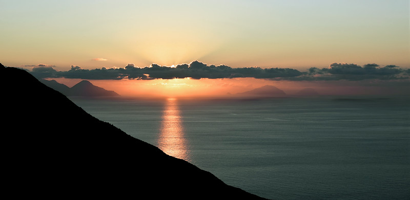 Tyrrhenian sea sunset over the islands of Salina, Filicudi and Alicudi, as seen from Stromboli (Italy)