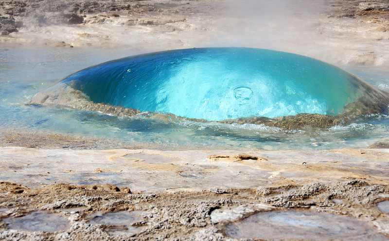 Bulge of water and steam at start of geysir eruption, Iceland