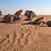 Sculpted Permian fluviatile sandstones protruding from sandy sabkha in the northern Huqf region, Oman
