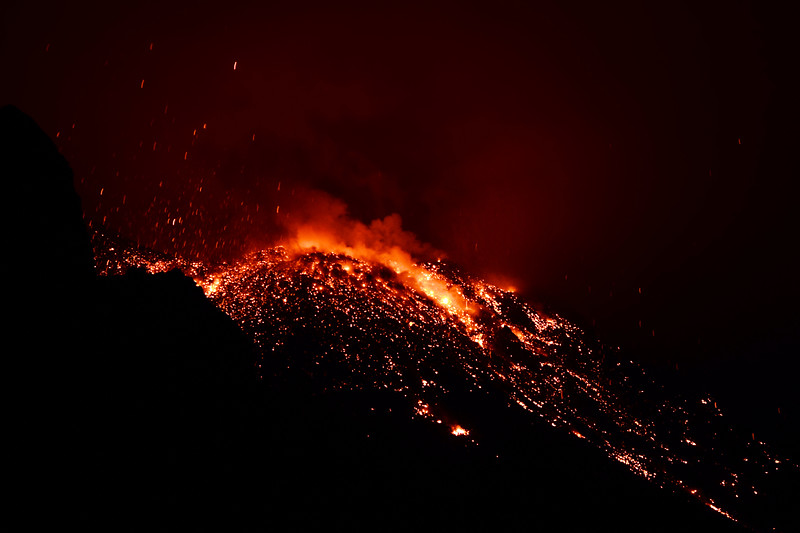 White hot lava bombs strewn around the Stromboli summit crater, Italy