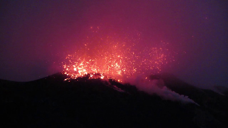 Hot lava spewing out of the main crater at Stromboli island, Italy