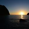 Sunset over the Tyrrhenian Sea, from the Punta Perciato cliffs in northwest Salina island towards the Scoglio Faraglione rocks