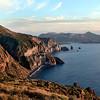 Looking along the coastal cliffs of Valle Muria on Lipari towards Vulcano island, Italy