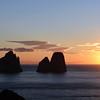 Winter sunrise over sea stacks (faraglioni) along Capri's southern shore, Italy