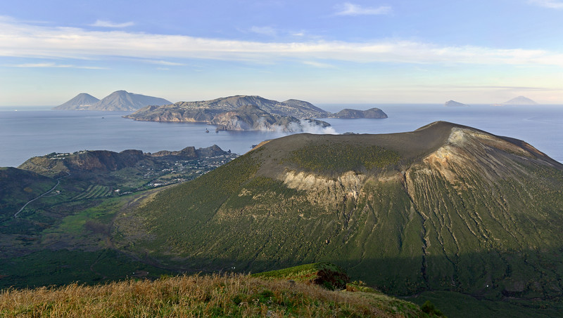 Northward view across the ancient caldera and active central vent of Vulcano island, with Lipari and Salina at centre and left, and Panarea and Stromboli at right