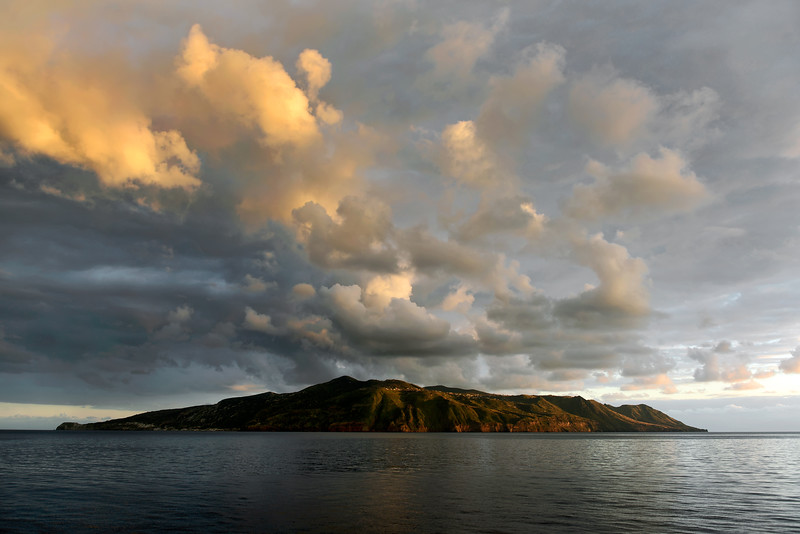 Late afternoon cloud formations over the island of Lipari, Italy