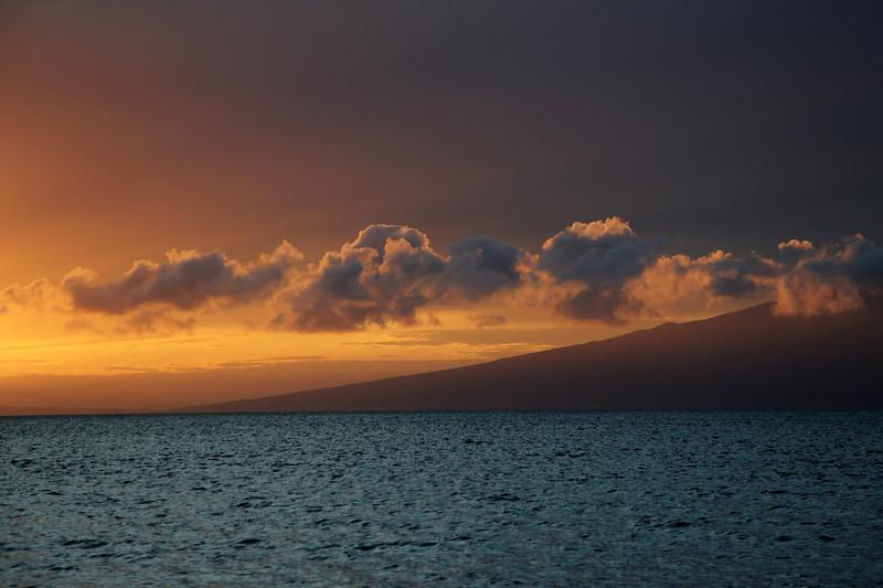 Red twilight over the slopes of Moloka'i island, Hawaii