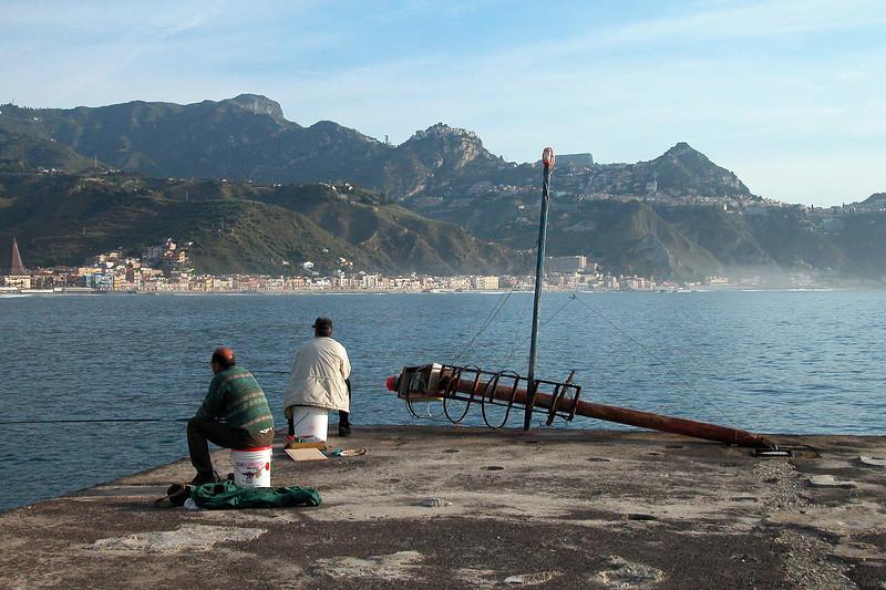 Early morning sea anglers near Taormina, Sicily