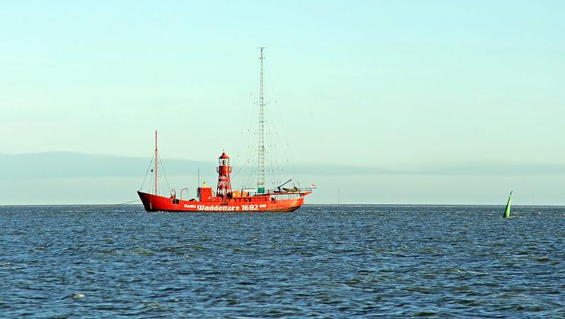 Radio-lightship Jenni Baynton in the tidal Wadden Sea, The Netherlands