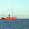 Radio-lightship Jenni Baynton in the tidal Wadden Sea, The Netherlands