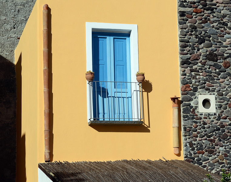 Detail of restored villa along the waterfront of Santa Marina on Salina island, Italy
