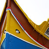 Brightly painted fishing boat in Marsaxlokk, Malta