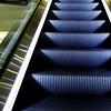 Side-illuminated moving stairway in upmarket London shopping mall, UK