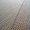 Tyre track in wind-rippled, coarse grained desert sands of interior Libya