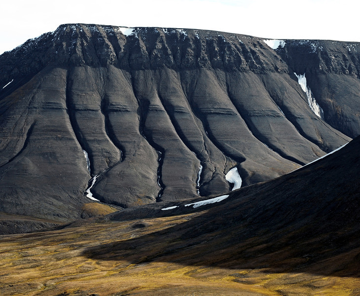 Tertiary sedimentary rocks exposed in the Ekholmfjellet (597 m) and Firkantdalen, Svalbard