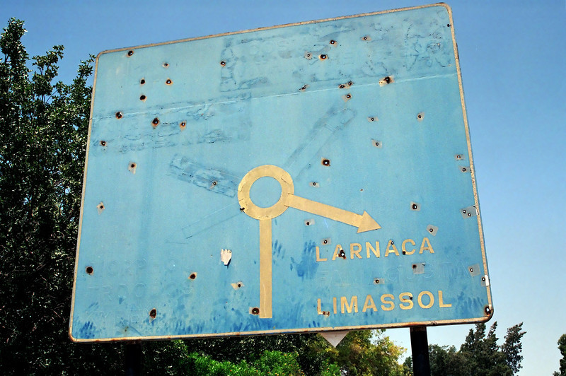 Larnaca roadsign showing direct and indirect impact of 1974 war, Cyprus