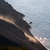 Fresh volcanic bombs rolling along the steep Sciara del Fueco slope of the Stromboli volcano into the sea, Italy