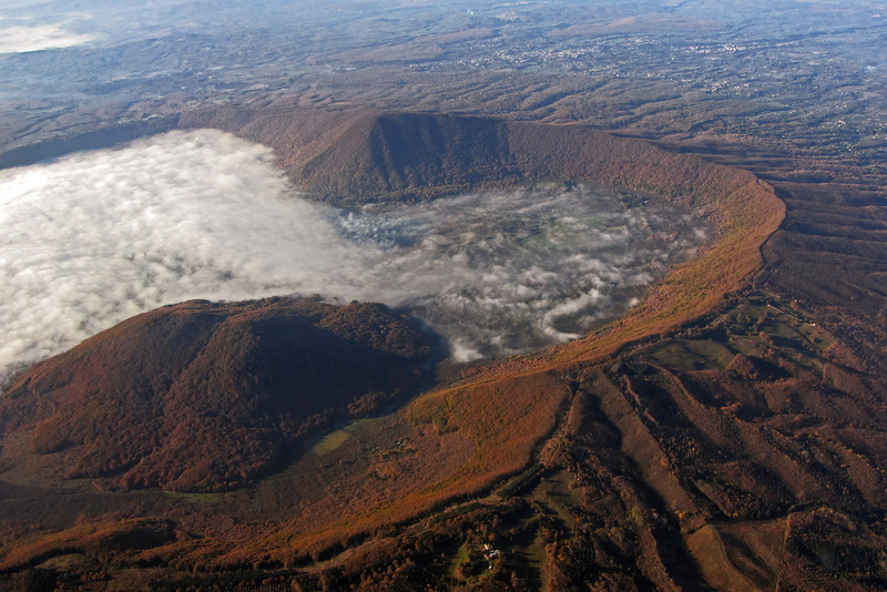 Morning mist in the extinct volcano crater of Monte Venere, central <br /> Italy
