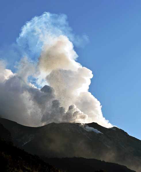Eruption of steam and lava bombs from the Stromboli volcano, Italy