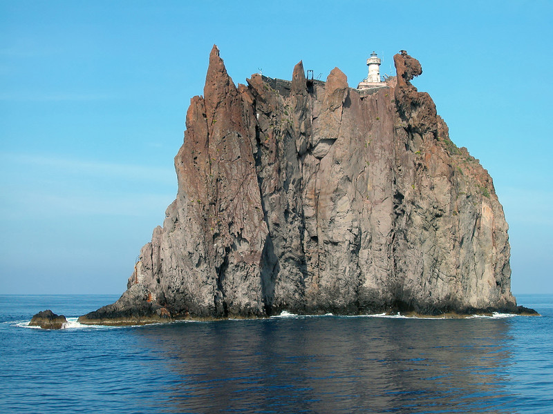 Lighthouse on the exhumed volcanic pipe of Strombolicchio in the Eolian Islands, Italy