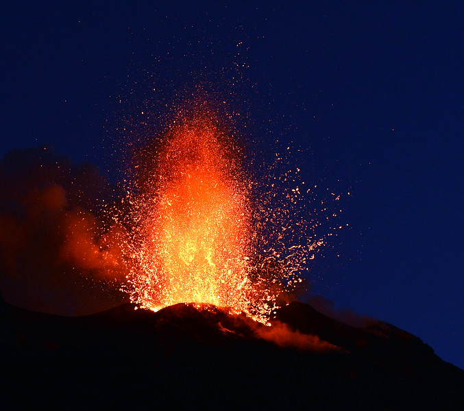 Explosive lava fountain rising from the Stromboli volcano, Italy