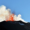 Red hot lava explosion at the summit crater at the Stromboli volcano, Italy