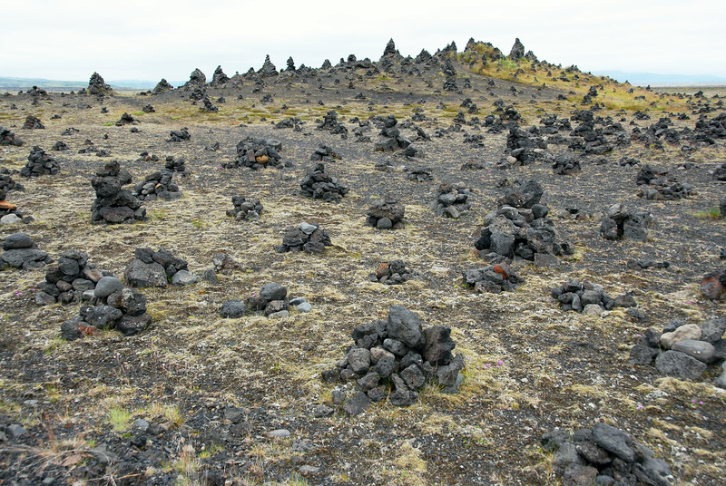Lava mound dotted with small cairns at Laufskalar, Iceland
