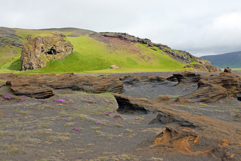 Derelict farm in the Dyrholaey area surrounded by lavas and tuffs, southern Iceland