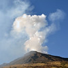 Tall steam cloud with fine ash rising from the Stromboli volcano, Italy