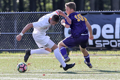 Ki Costa (left) from Point Pleasant Beach battles with Matt School (right) from St. Rose as St. Rose High School hosted Point Pleasant Beach High School in a boys varsity soccer game held in Tinton Falls on Wednesday October 3, 2018 (MARK R. SULLIVAN /THE COAST STAR)